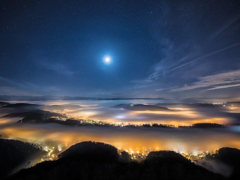 Bright City Lights Under Dense Fog