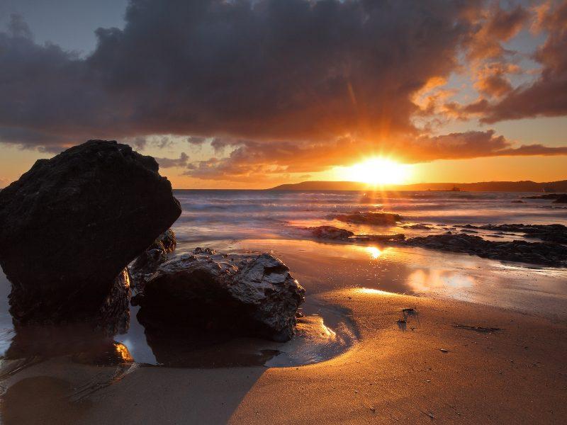Beach Sunset Landscape Between Rocks